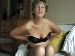This 50-something mom takes off her bra and shows us her tits, squeezing them, profiling them, lifting 'em and playing with her nipples.