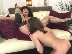 Sympathetic juvenile sweetheart Nelly Sullivan and her experienced dark brown milf Regina in the action
