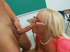 Glamorous spectacled blond teacher Alexis Golden is having nice sex with her student Danny Mountain in this movie. She is kneeling and beginning to perform hot fellatio.