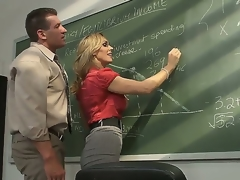 Outstanding golden-haired milf pornstar Tanya Tate with a big and very palatable breasts seduces her student in the classroom. This hot doxy gets licked on a table and with a pleasure sucks a cock.