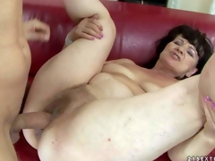Helena May is s sex obsessed oldie with moist shaggy pussy. Undressed experienced woman parts her legs on the edge of the couch and gets her wet crack drilled by her young hard dicked lover