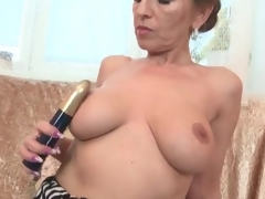 Milf with splendid large scoops fingers her cunt