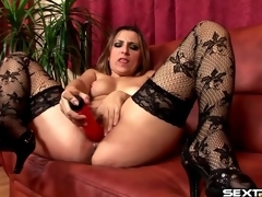 Red dildo fills soaking moist mom fur pie