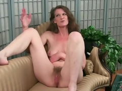 Mature strips exposed to show her hairy pussy