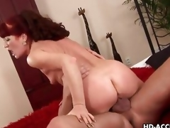 Mature redhead rides her cunt on this thick dick