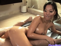 Asian babe Asa Akira sucking a guy's weenie after a slutty nuru massage