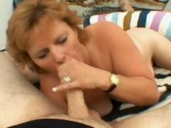 Slutty golden-haired grandmother Megan engulfing a big young prick with longing