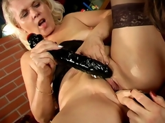 Trashy lesbo grannies Marketa And Leona licking their succulent pussies and sharing a huge dildo