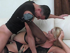 Dolled-up mommy makes her bawdy cleft ready for a rock-hard shaft of a hung stud